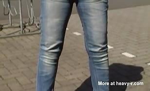 Blonde milf peeing in blue jeans
